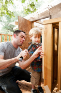 stock-photo-21922418-father-and-son-build-tree-house