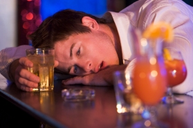 Drunk young man passed out in bar
