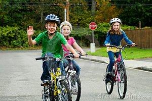 happy-kids-riding-bikes-22095492