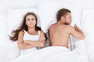 man-and-woman-in-bed-angry