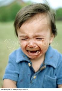 toddler-crying-with-his-face-covered-in-chocolate-ice-cream