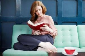 1412354284_Woman_reading_a_book_on_sofa_xlarge