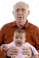 3892369-old-man-holding-the-cute-baby-against-white-background-Stock-Photo
