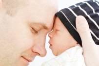 Dad-holding-newborn-son-1050x700