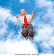 stock-photo-tiny-newborn-baby-smiling-flying-up-into-the-sky-and-clouds-kid-wearing-a-white-shirt-and-red-tie-111230300