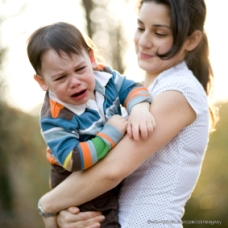 istock_patrickheagney-1-mother-holding-crying-child-c