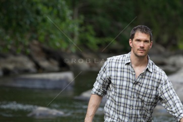 rugged-man-walking-by-a-stream-in-Upstate-New-York